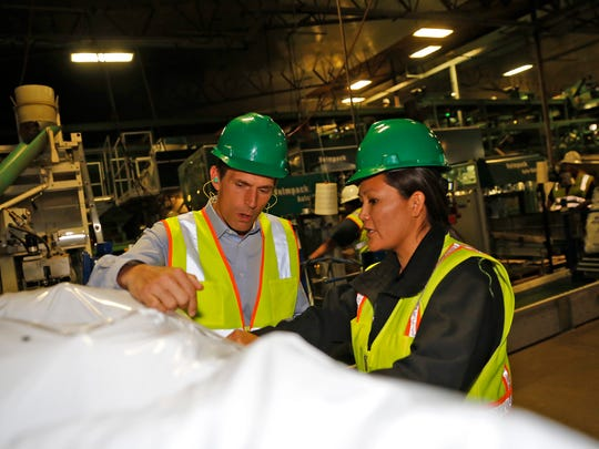 U.S. Sen. Martin Heinrich talks to Dineh John,  quality assurance manager, Friday during a tour of the Navajo Agricultural Products Industry facility south of Farmington.