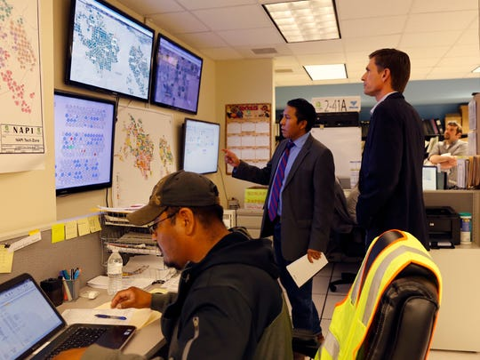 Lionel Haskie, operations and maintenance manager of the Navajo Indian Irrigation Project, talks with U.S. Sen. Martin Heinrich Friday during a tour of Navajo Agricultural Products Industry headquarters south of Farmington.