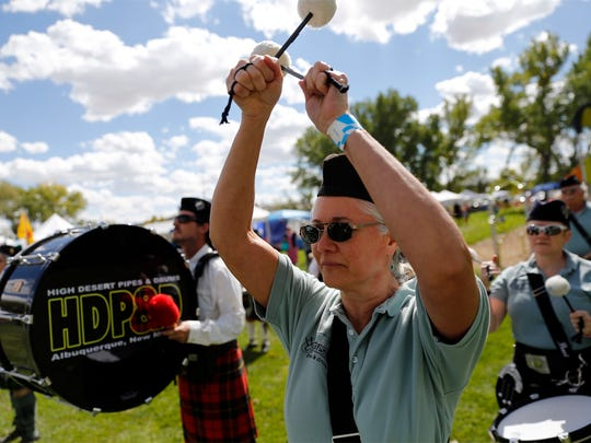Morgan Crawford, a member of the Westward Pipes and Drums, marches with other performers Saturday during the Aztec Highland Games and Celtic Festival at Riverside Park in Aztec.