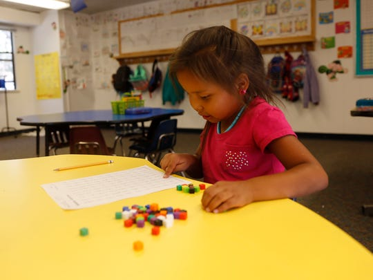 First grader Kierra Todachinnie works on math problems on Wednesday at Dream Diné Charter School in Shiprock.