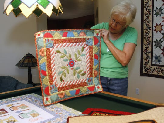 Cheryl Hough shows a quilt by Kim Duke titled Hope