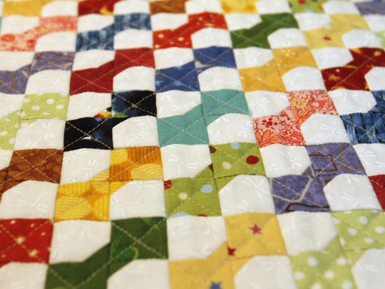 A detail of a bow-tie style quilt by Dixie Jackson