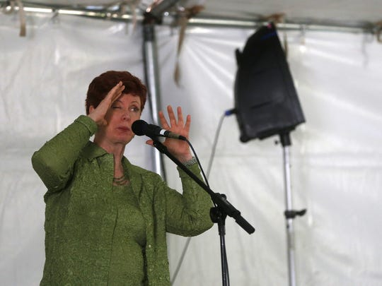 Susan O' Halloran entertains a crowd with a story Saturday during the Four Corners Storytelling Festival at Berg Park in Farmington.