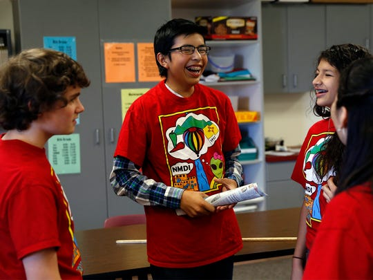 Jacob Gomez talks with his Destination Imagination teammates on Oct. 14 at Mesa View Middle School in Farmington.
