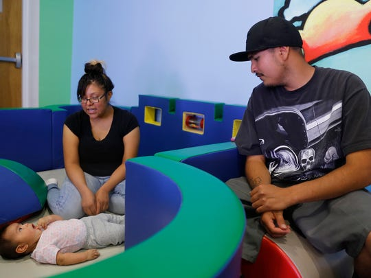 Demetria Scott and Stephan Trujillo play with their daughter, Denise Trujillo, on Sept. 23 at the E3 Children's Museum and Science Center in Farmington.