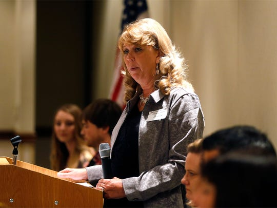 Desk and Derrick Club of Farmington President Sheryl Clark speaks Thursday during the club's 2015 Industry Appreciation Dinner at the Courtyard by Marriott.