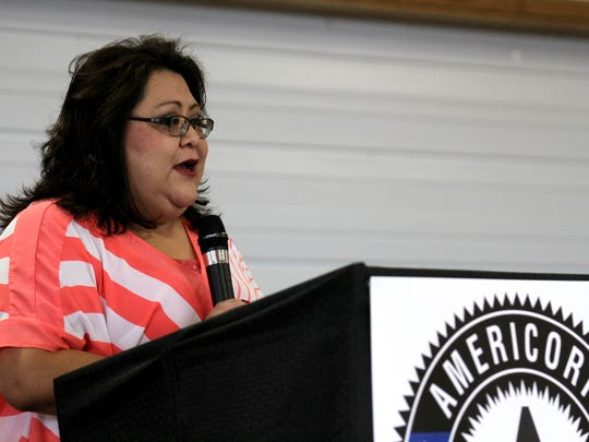 AmeriCorps alum Miranda Bekis talks about her experience on Friday during a ceremony at the Nenahnezad Chapter House.