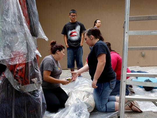 Bloomfield High School seniors work on preparing a haunted house on Saturday at Bloomfield High School.