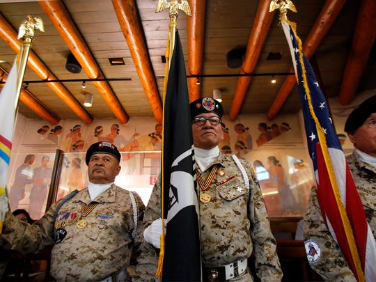 Members of the Tohatchi Veterans Organization Color Guard stand ready on Monday before the start of the Navajo Nation Council fall session at the Council Chambers in Window Rock, Ariz.