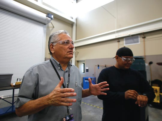 Tony Otero, San Juan College School of Energy program coordinator and process technology professor, talks with student Jordan Domingo during an interview Sept. 10 at San Juan College's School of Energy in Farmington.