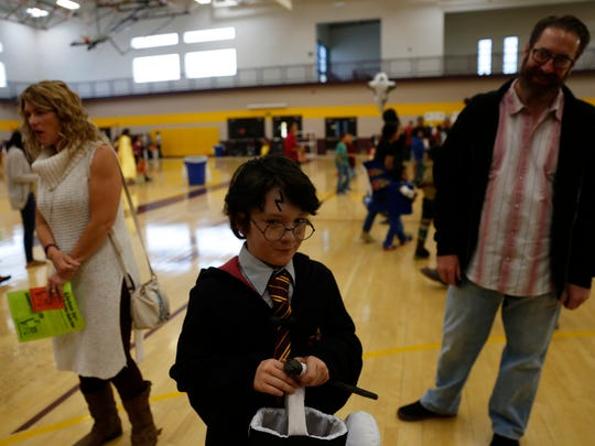 Jasper Sandel gets ready to play games dressed as Harry Potter Saturday during the San Juan College Halloween Festival in Farmington.