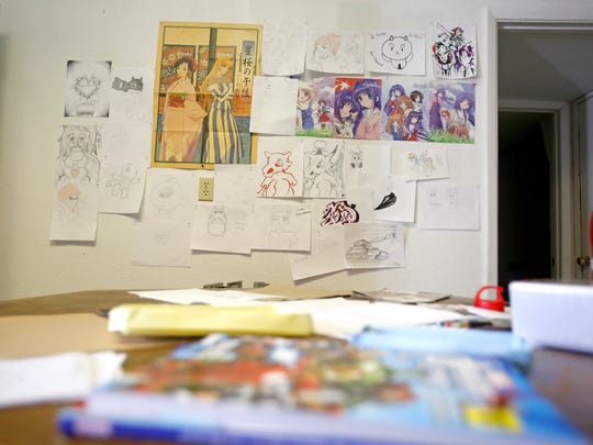 Artwork from customers hangs on Monday at Ichigo Comics in Farmington.