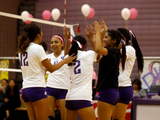 Kirtland Central players celebrate after scoring a point against Shiprock on Tuesday at Bronco Arena in Kirtland.