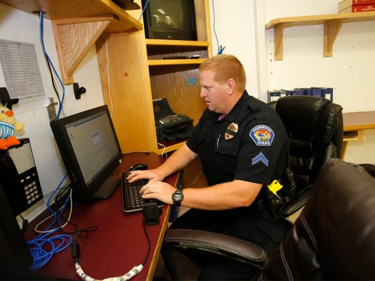 Cpl. Jared Stock demonstrates how body camera video is stored Friday at the Farmington Police Department.