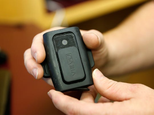 Cpl. Jared Stock shows off a body camera,  Friday at the Farmington Police Department.