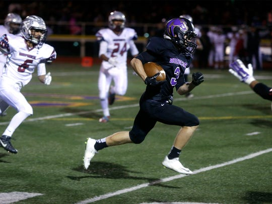 Kirtland Central's Aiden Cockrell carries the football in to the end zone for a touchdown against Shiprock on Friday at Bronco Stadium in Kirtland.