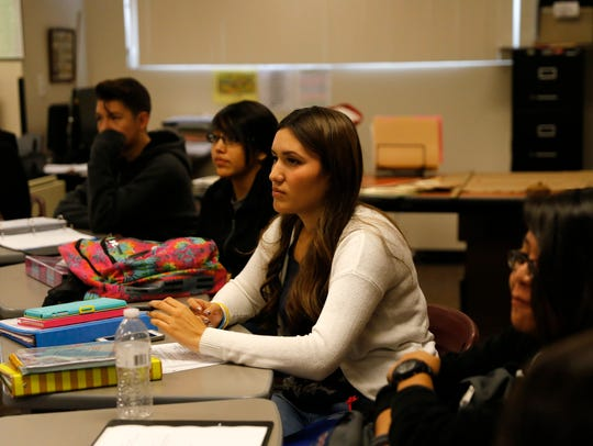 At center, student Tyra Nicolay participates in a class