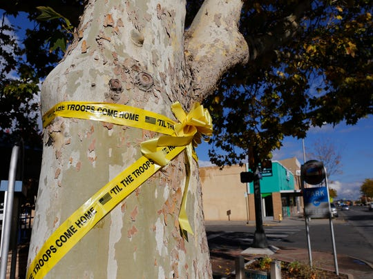 Yellow ribbons in support of the military are tied