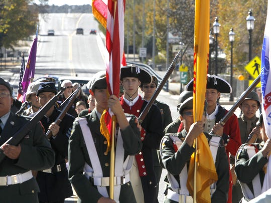 The Kirtland Central High School JROTC walks down Main Avenue in Aztec on Nov. 8, 2014, during the Veterans Day parade.