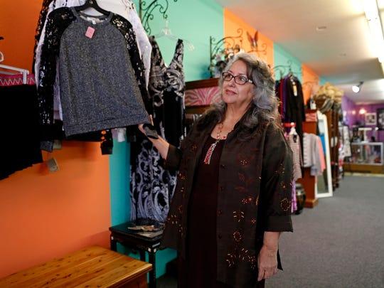 Owner Maria T. Garcia looks through her merchandise