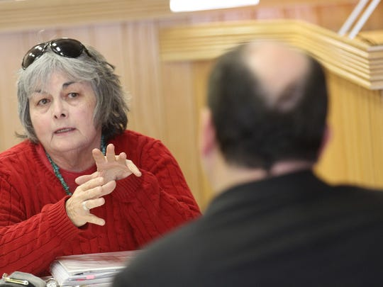 City Councilor Mary Fischer speaks with U.S. Department of  Housing and Urban Development enforcement analyst Jerry Creamer Wednesday during a meeting at City Hall in Farmington.