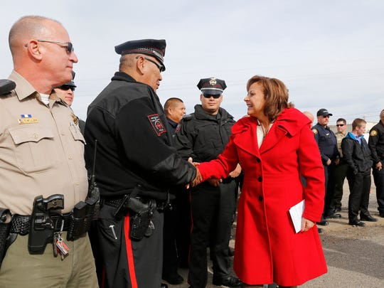 Gov. Susana Martinez shakes hands with law enforcement