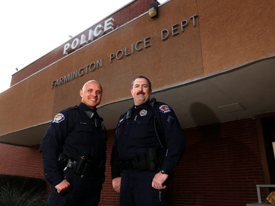 From left, Farmington Police Department Patrol Officer Keith Herrera and Cpl. Albert Boognl pose for a portrait on Monday outside the police department headquarters in Farmington.