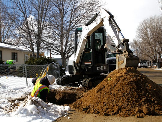A crew with Sunrise Technology Utilities Network Corp. works on moving a gas line for New Mexico Gas Company on Wednesday along Western Circle in Aztec. Crews are moving the gas line to make way for a new sewer line.