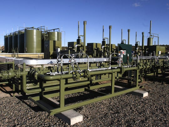 An oil and gas production site is pictured Nov. 3, 2014, in Lybrook.