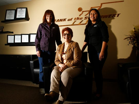 From left, Robin Roy, Bank of the Southwest's vice president and Small Business Administration administrator; Georgia Gramlich, senior vice president and division manager; and administrative assistant Lisa Zohnnie pose for a portrait on Friday at the new Commercial Loan Center in Farmington.