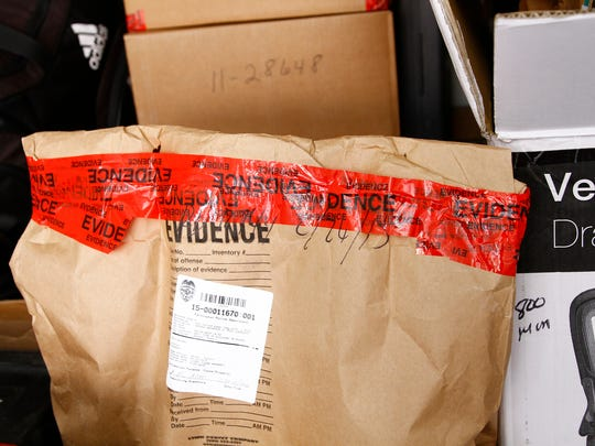 Boxes and bags filled with evidence sit in a truck on Tuesday at the Farmington Police Department.