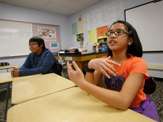 Eighth grade student Elijah Begay and 6th grader Hannah Pengosro on Wednesday talk about participating in the upcoming U.S. Department of Energy Office of Science National Science Bowl during lunch time at Newcomb Middle School.