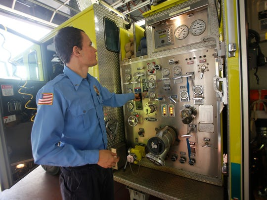 Ian Rutter, an engineer with the Bloomfield Fire Department, checks the water pressure on a fire engine at the start of the shift on March 4 at the Bloomfield Fire Department.