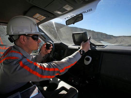 Joshua Kantor, BHP Billiton superintendent of drilling and blasting, leads a tour Thursday at the Navajo Mine in Fruitland.
