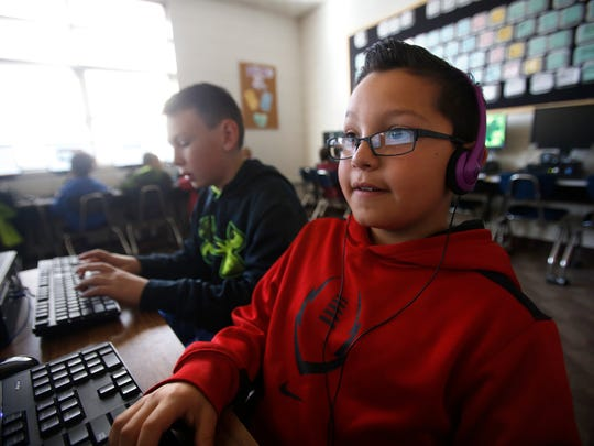 Fourth graders Javan Williamson, left, and Joshua Florez complete class work on Tuesday during computer class at Blanco Elementary School.