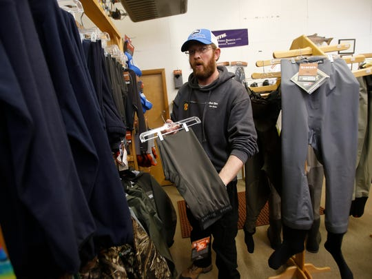 Float 'N Fish salesman Matt Van Sickle talks about the clothing needed for fly-fishing at his store, Float'N Fish in Navajo Dam, on Tuesday.