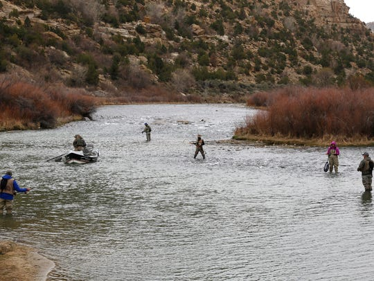 Anglers fish on March 29 at the Texas Hole on the San