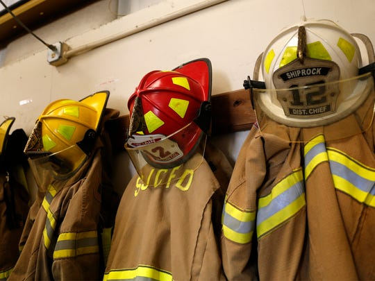 Firefighting gear hangs from hooks on Oct. 22 at the