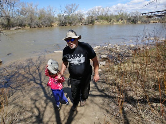 John Lehleither walks with his granddaughter Charlotte
