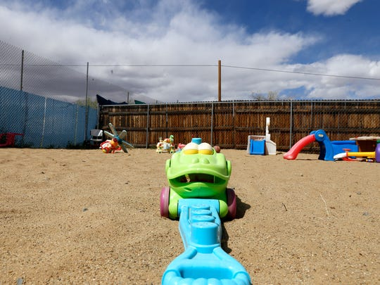 Toys are scattered at a play area at the Home for Women