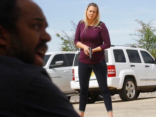 Public Safety Psychology Group role-playing actor Darryl Deloach, left, talks with Farmington Police Department Officer Amy DeMar during a crisis intervention training scenario on Friday at the Fraternal Order of the Police headquarters in Farmington. Deloach was playing the role of an armed suspect exhibiting mental health problems.