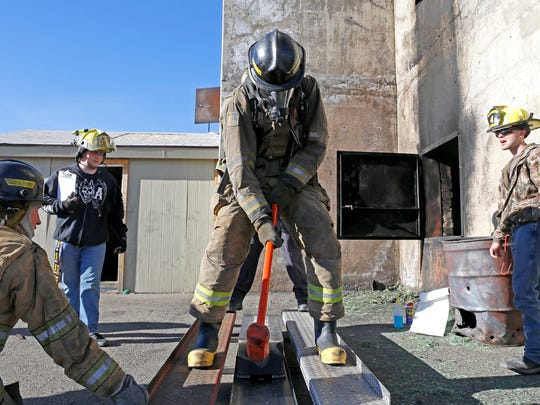 Brandon Armstrong competes in the Combat Challenge on Jan. 23, 2015, at San Juan College's fire tower in Farmington.