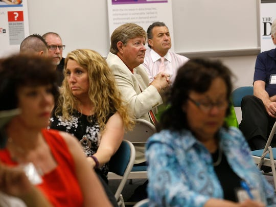 CyberCon Four Corners conference goers listen to an address Thursday at the Quality Center for Business at San Juan College in Farmington.