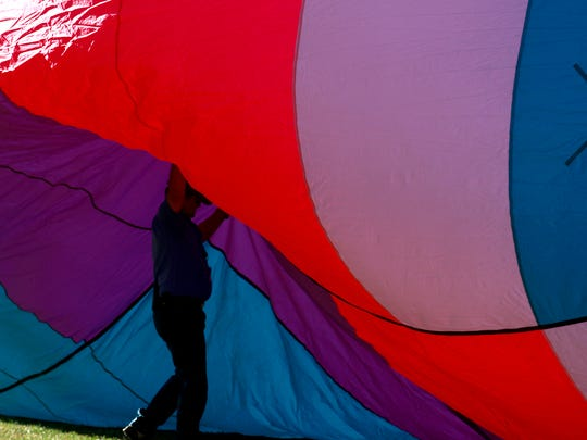 Lenny Steeves sets up a hot-air balloon on Friday during the San Juan River Balloon Rally in Bloomfield.