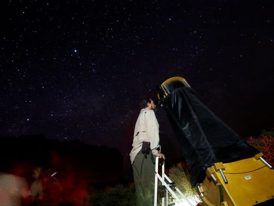 Don Emerson of Austin looks through a telescope during a night sky program at Chaco Culture National Historic Park.