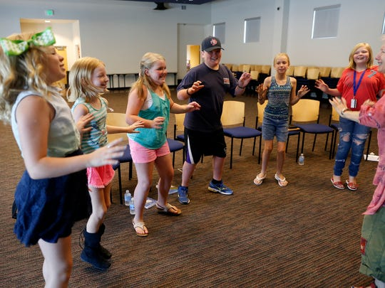 Participants in a storytelling workshop take part in an exercise Wednesday at the Farmington Public Library.