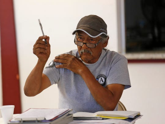 Joe Ben Jr., the Farm Board member for Shiprock Chapter talks Tuesday duringa  meeting between tribal and federal officials at the Gadii'ahi-Tokoi Chapter House.
