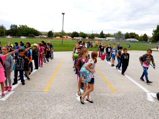 Students line up to go inside Sept. 3 before school begins at Lydia Rippey Elementary School in Aztec.