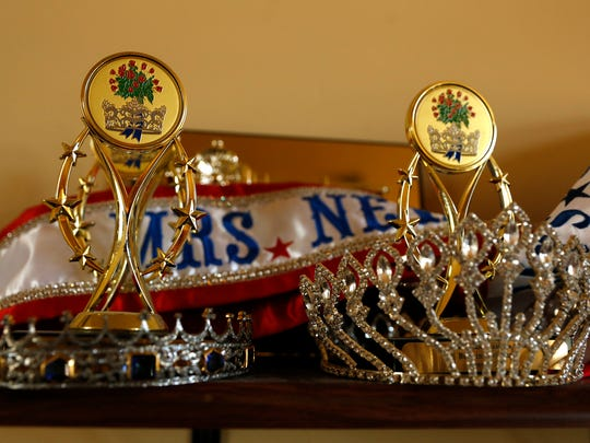 Summer Jakino-Whistle's crowns, awards and sashes are displayed at her home in Aztec on Monday.