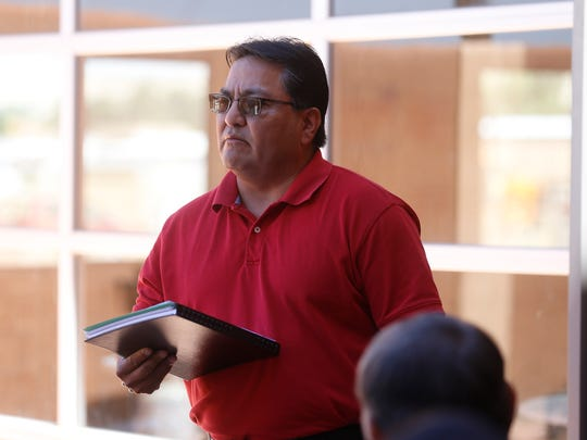 Donald Benn, executive director of the Navajo Nation Environmental Protection Agency, speaks on Thursday at a meeting with Nageezi residents at a Bloomfield hotel.